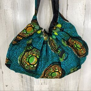 handmade travel hobo bag with paper bead design